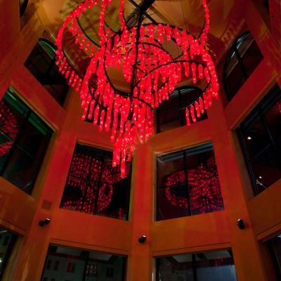 Crimson Cascade Hand Blown Glass Chandelier Lighting Installation night
